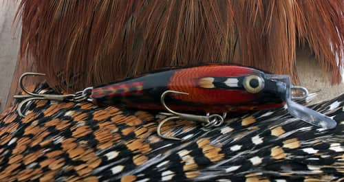 Red fishing lure and feathers